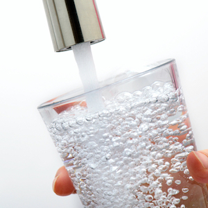 Water pouring in a cup