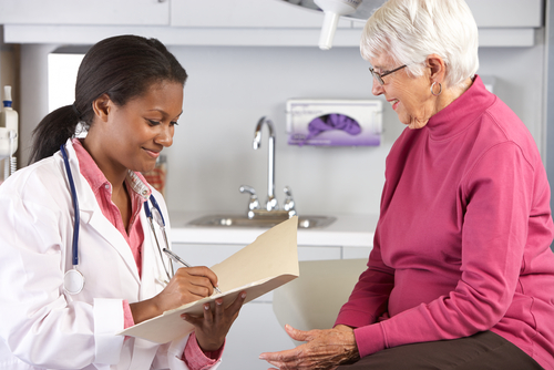 Female doctor consulting an elderly female patient.