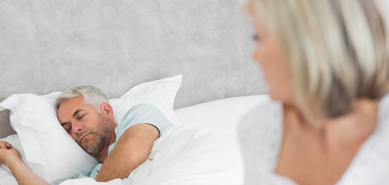 Man sleeping restlessly