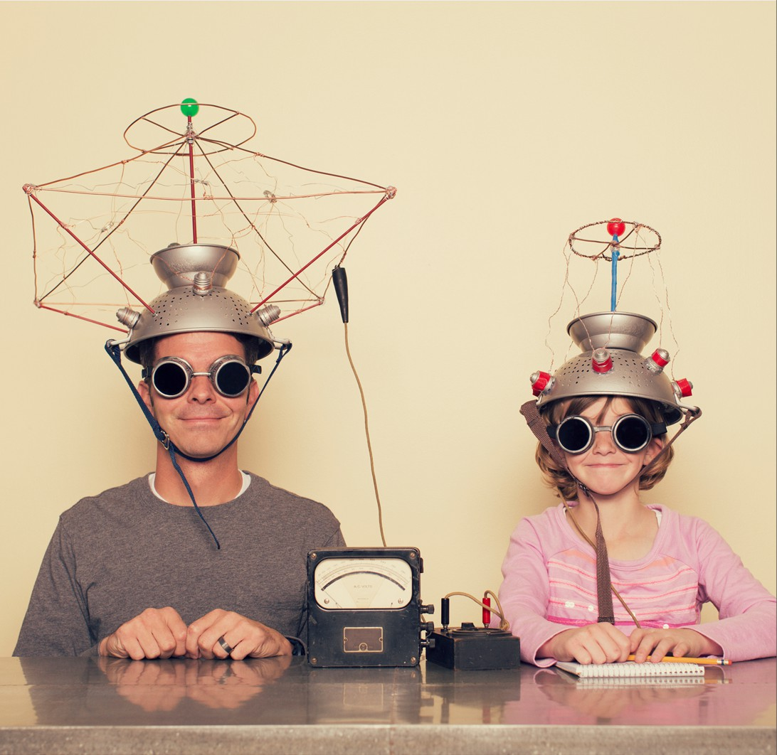 man and girl with antenna caps and goggles