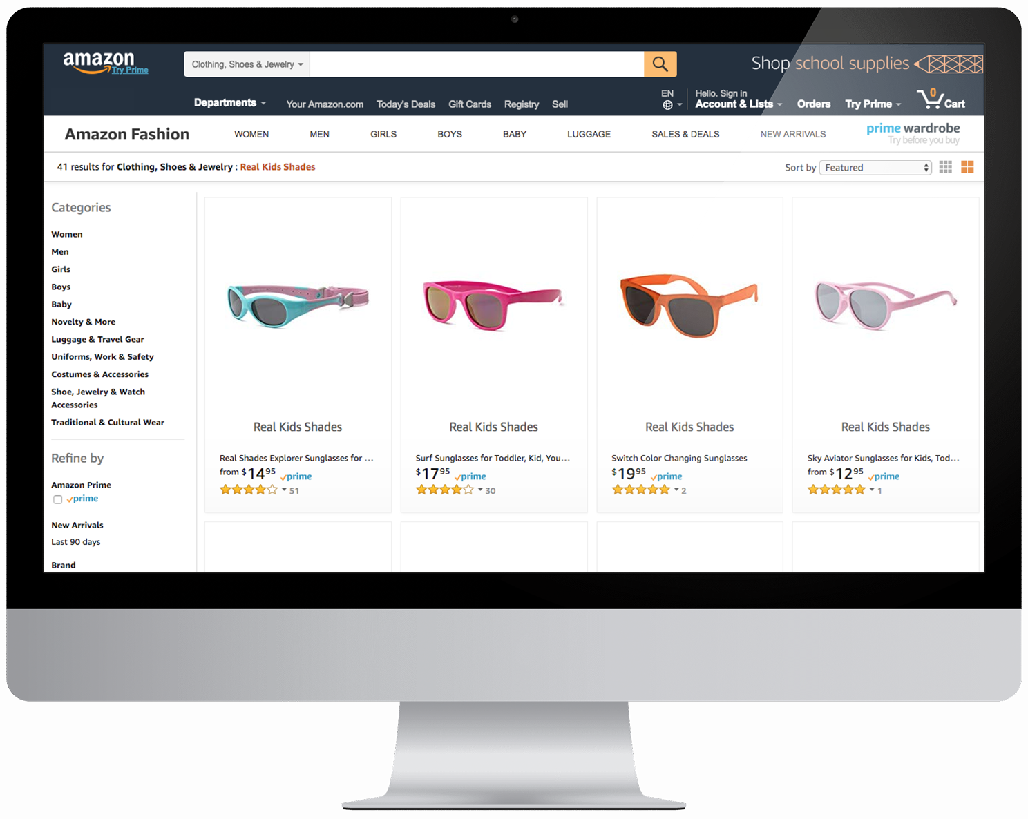 Computer with screenshot of Amazon Real Kids Shades listings
