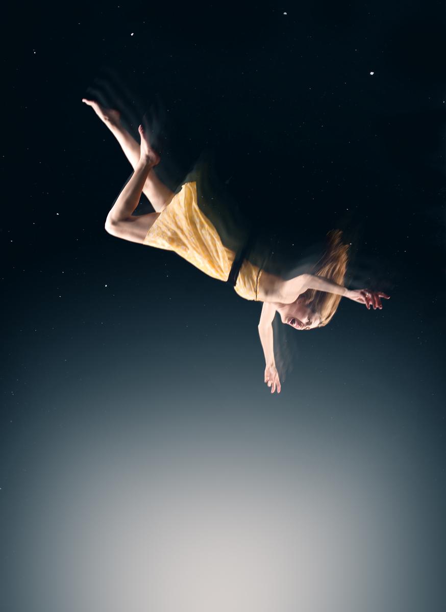 A conceptual image of a woman falling in a dream.