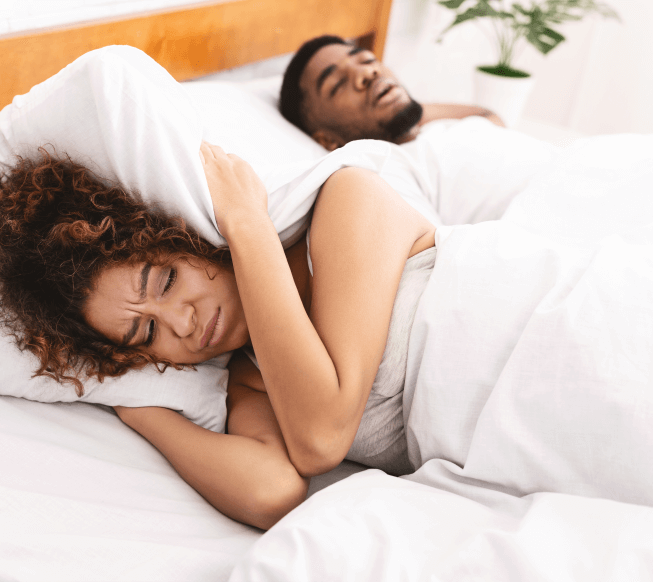 tired and annoyed woman of her partner snoring
