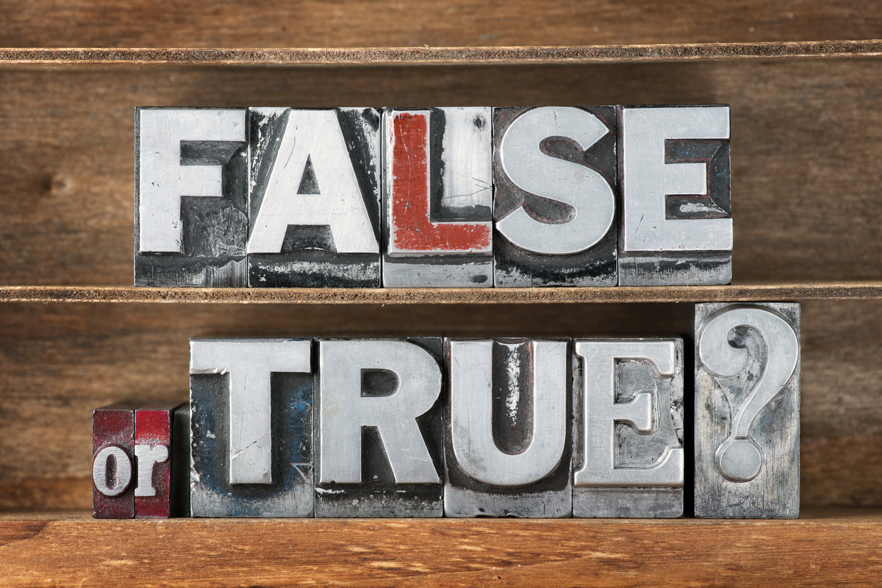 false or true question made from metallic letterpress type on wooden tray