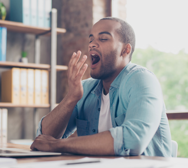 tired man yawning