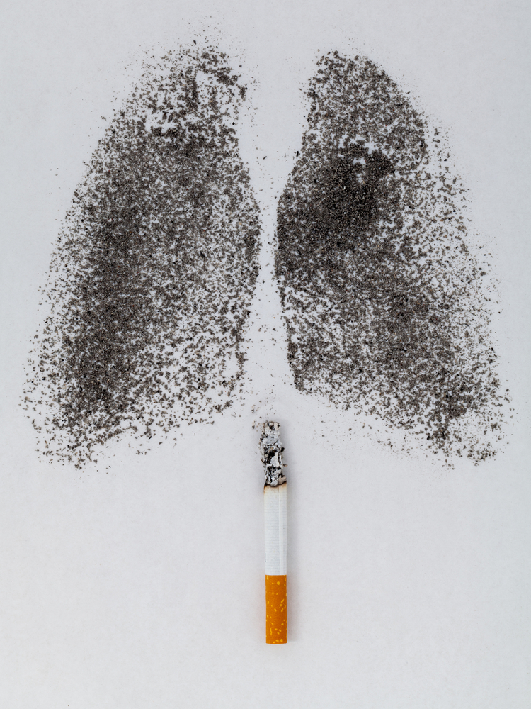 Lungs made out of charcoal dust with a cigarette below