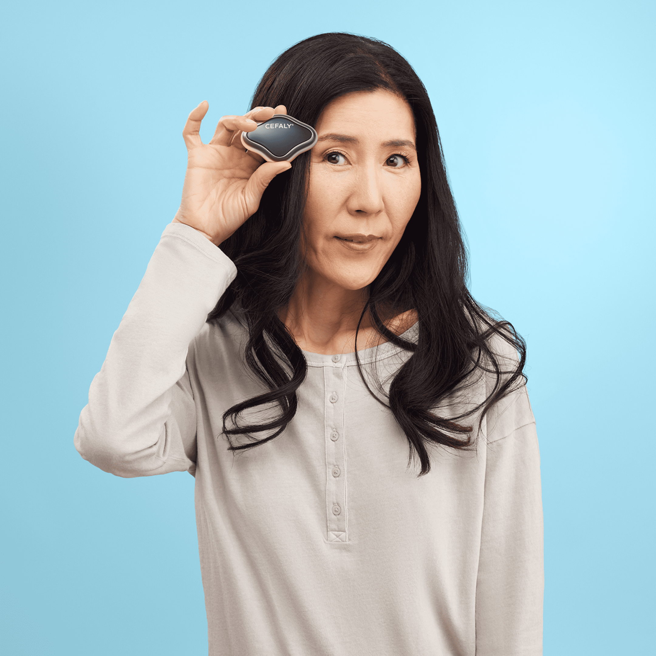Woman wearing a Cefaly Migraine treatment and prevention device on her forehead  6