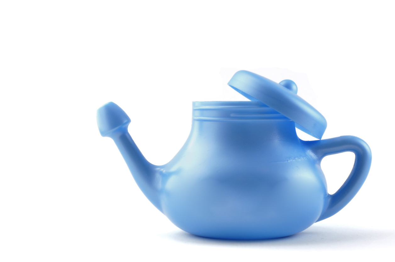A modern plastic, blue Neti Pot