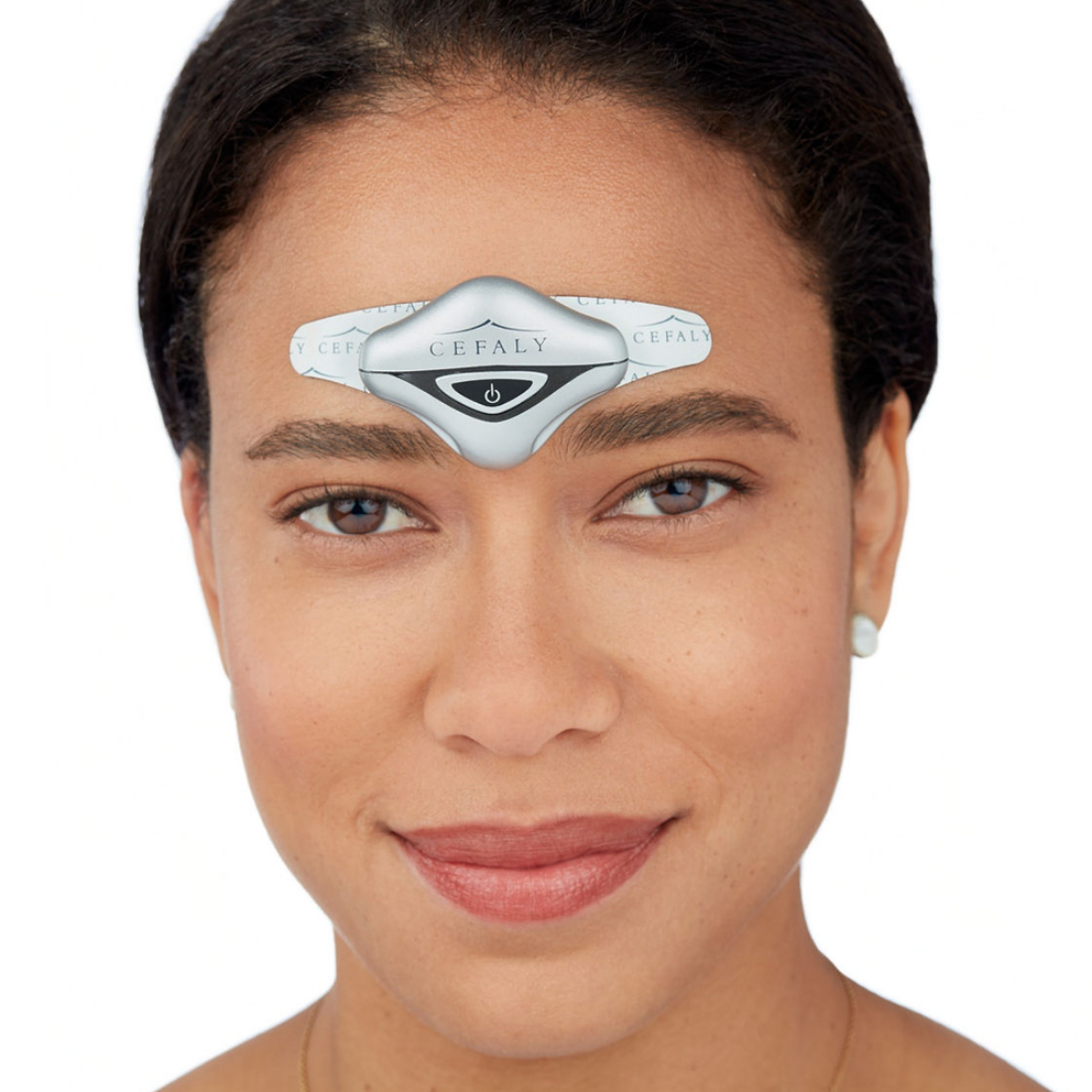 Woman wearing a Cefaly Migraine treatment and prevention device on her forehead